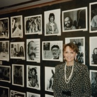 BY_Photo_1994_Barbara Young in front of wall of photographs by Ray Fisher_p1.jpg