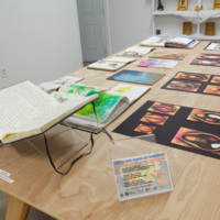 Installation view of Loni Johnson's sketchbooks and drawings